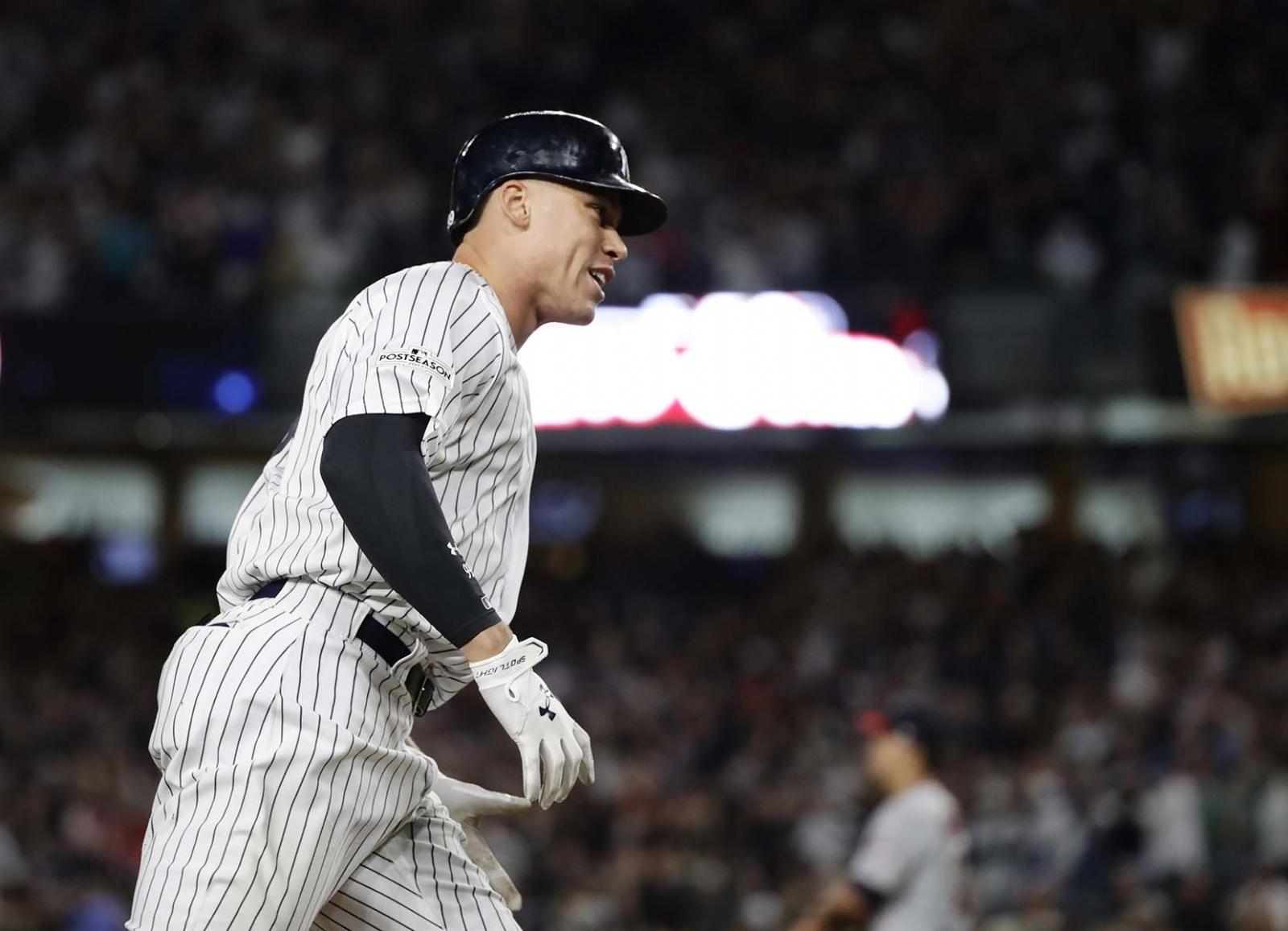 Con tres jonrones Yankees eliminan a Mellizos y van contra Indios