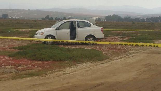 Asesinan a dos a bordo de vehículo